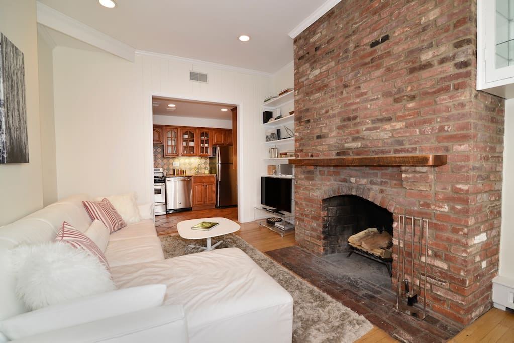 Comfortable living room with working fireplace and 4K HD TV