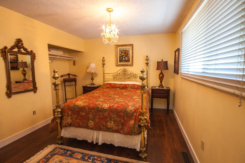 Bedroom C with a queen size bed and a private half bathroom on the main floor