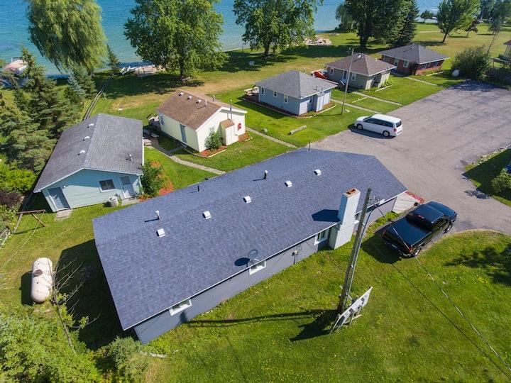 The Grand Retreat Lakefront Cottage & Suite estate
