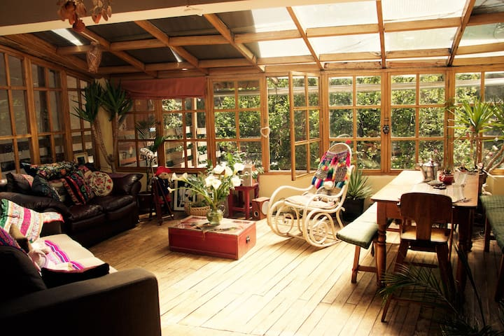cosy sun-lit wooden chalet with plenty of greenery