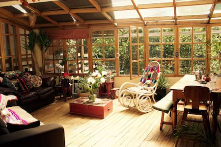 cosy sun-lit wooden chalet with plenty of greenery - Cusco