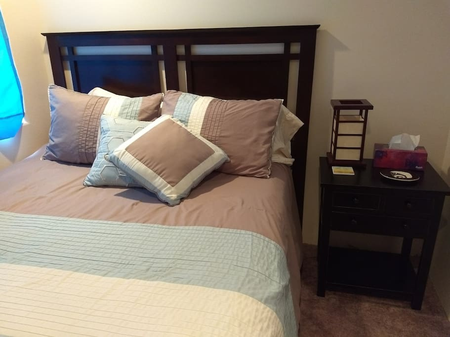 Queen bed with window, closet and night stand, sound machine with usb charger.