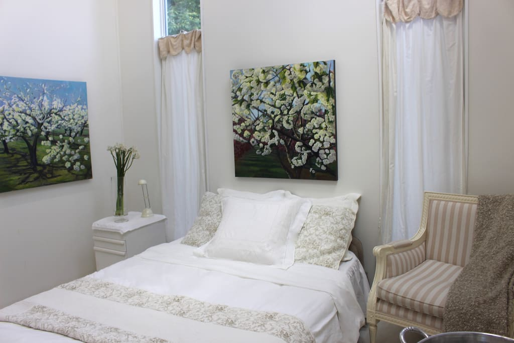 Bedroom features 16' cathedral ceiling with skylights + independent heating and cooling.  Original paintings line the walls.