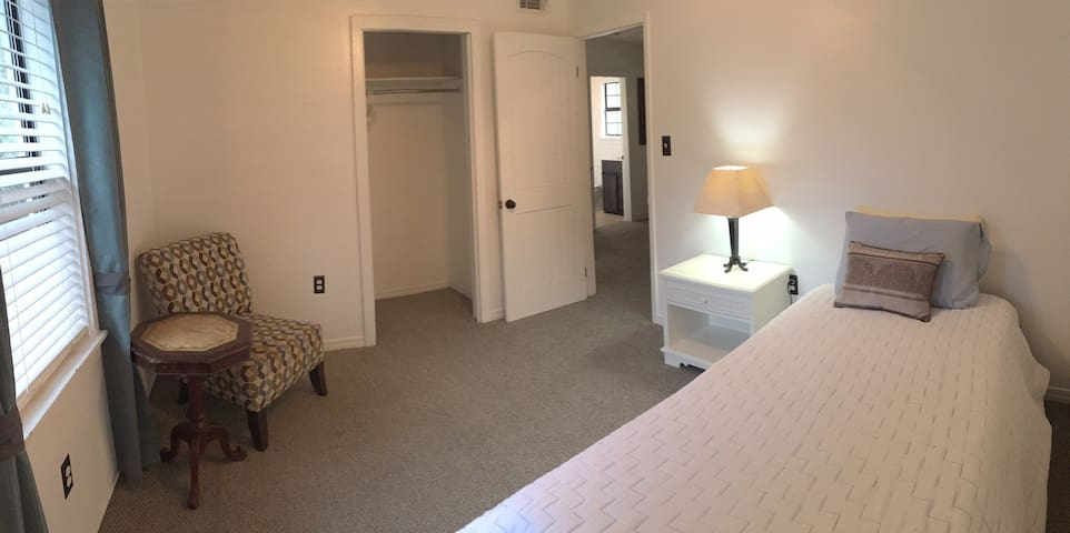 Single bedroom (twin bed), opens into the living room.