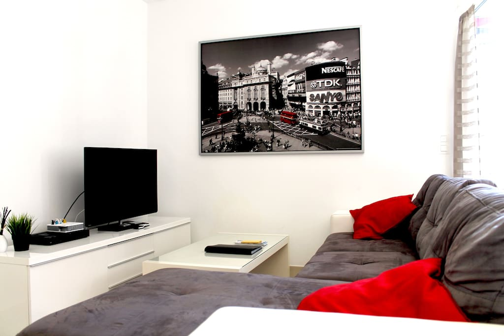 Living are with a comfortable sofa bed for 2 and a flat screen TV.