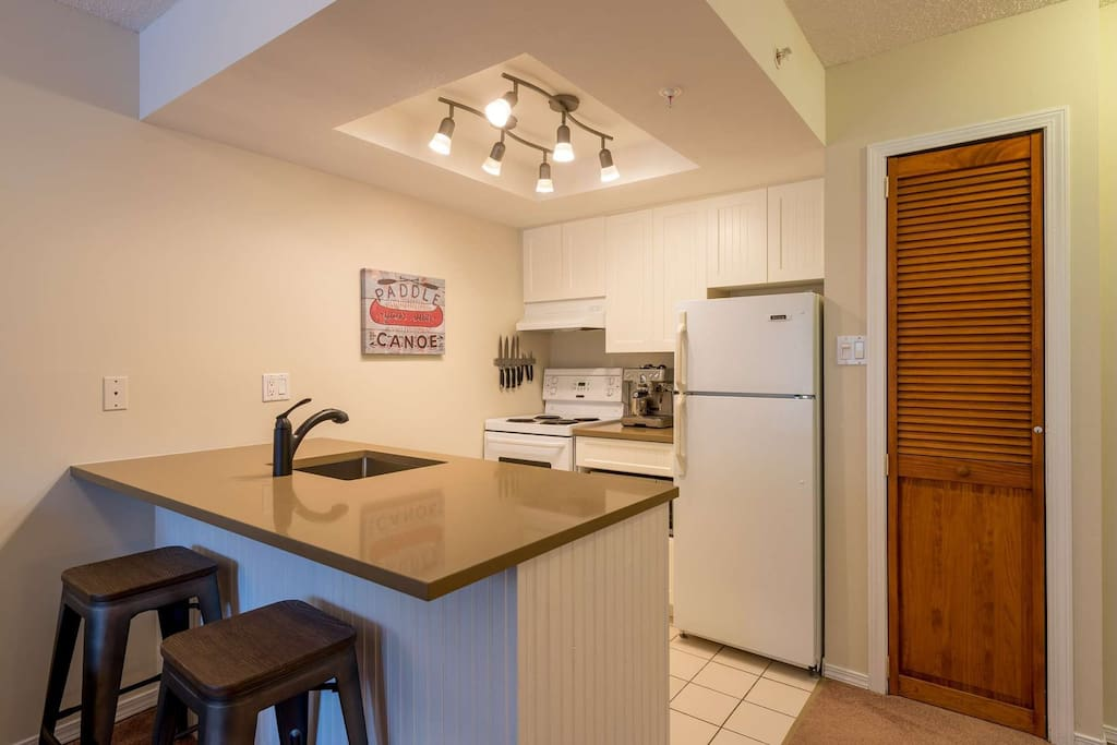 Kitchenette with stove,fridge and dishwasher. Well equipped with cooking utensils for your stay