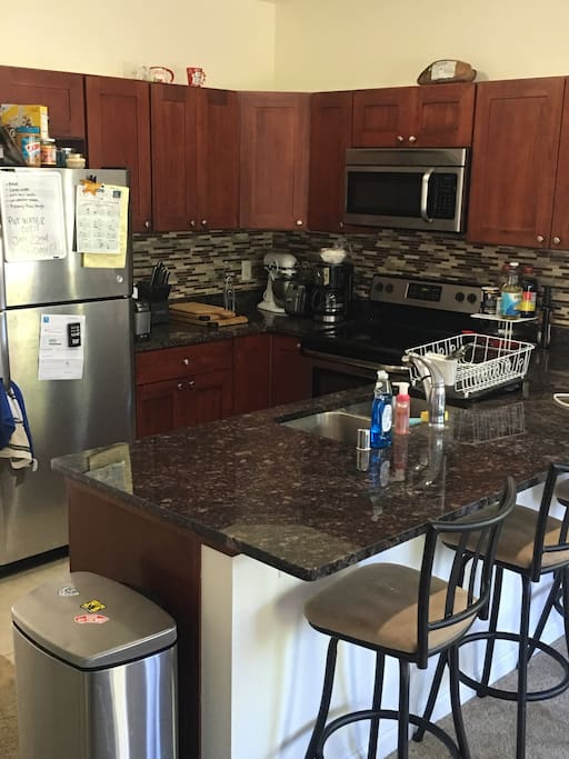 Shared Full kitchen available with bar and barstools
