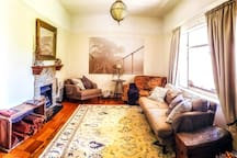 A spacious and comfortable lounge to cosy up around the fire complete with late 1800's farmhouse sink as a wood hold!