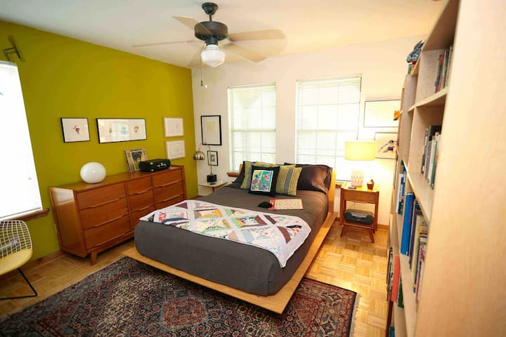 More art and Mid-century furnishings decorate the bedroom, featuring a comfortable queen size bed and lots of dresser drawer space for your convenience.  Enjoy a collection of vintage vinyl on the record player!