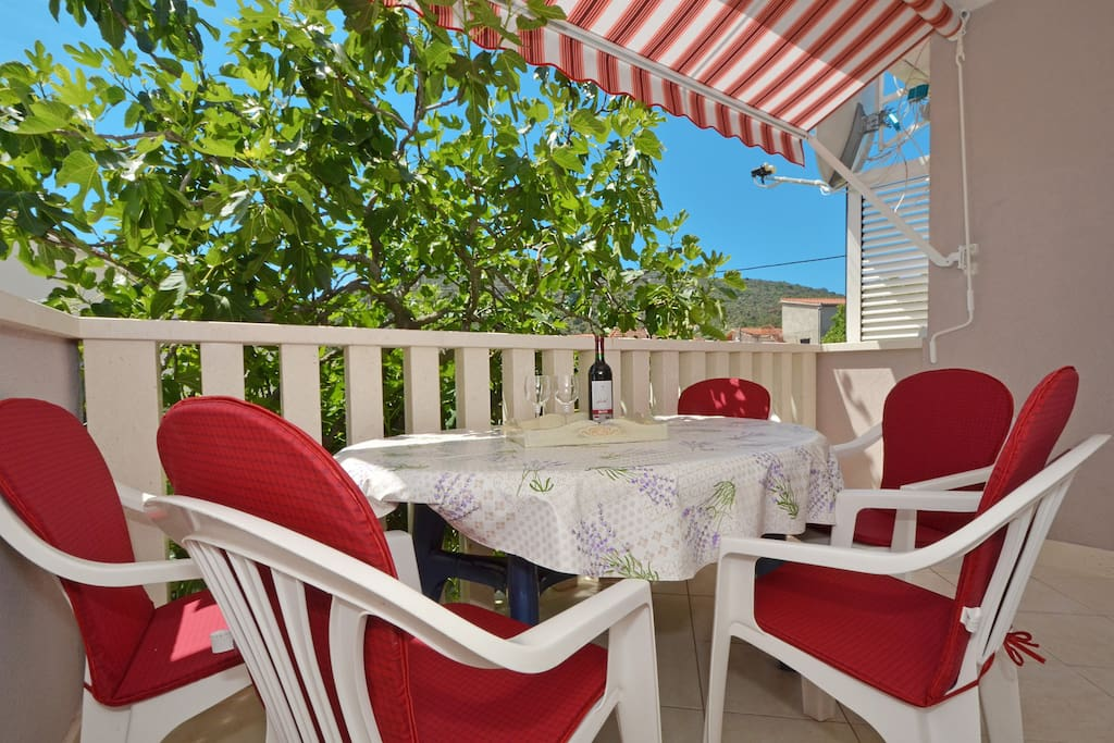 table with chairs on the balcony,you can feel healing odor of the sea