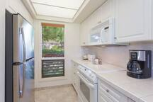 The remodeled kitchen features stove, oven, fridge/freezer, microwave and dishwasher