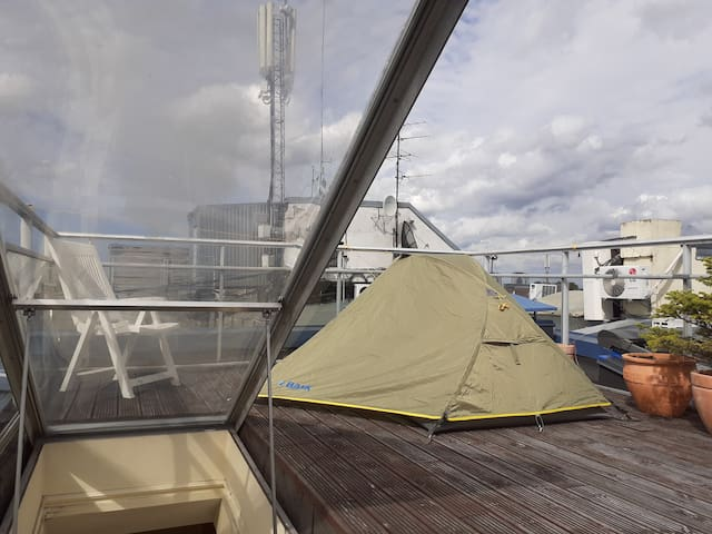 Tent on the roof in the center