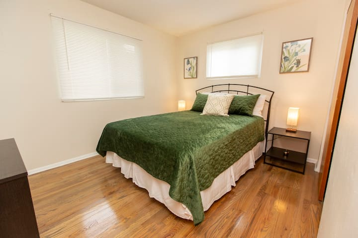 Spacious master bedroom features Queen sized bed and ample closet space.
