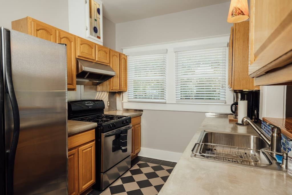 The kitchen features concrete countertops, gas cooking and a full size refrigerator.