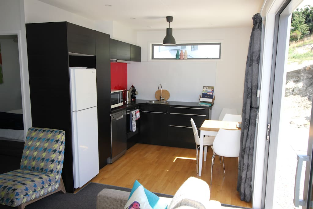 Kitchen with full fridge/freezer, oven, ceramic cooktop, microwave and dishwasher