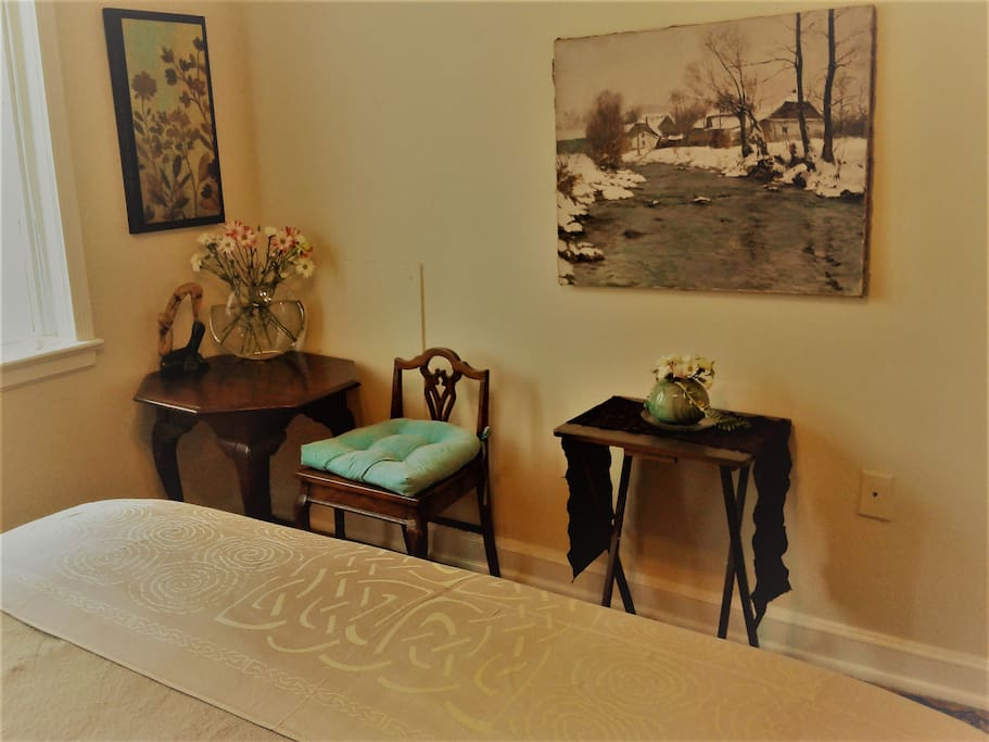 Your room - small antique table and paintings