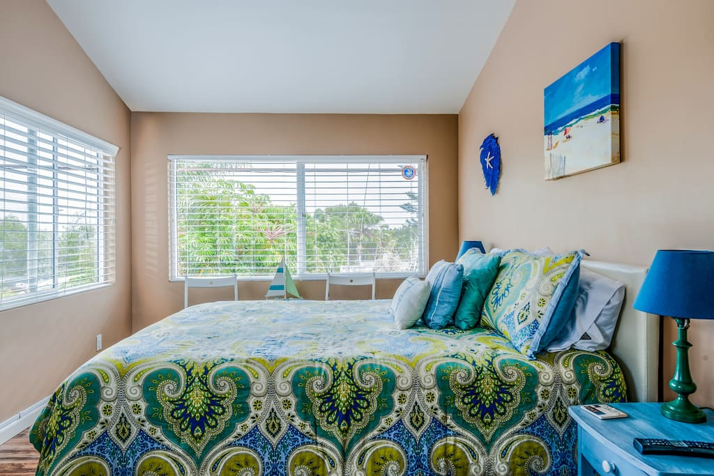 The Master Bedroom is filled with natural light and relaxing ocean views
