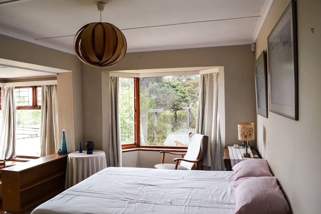 Main Bedroom with double bed. View over beautiful Fynbos Garden. Also have a study nook.