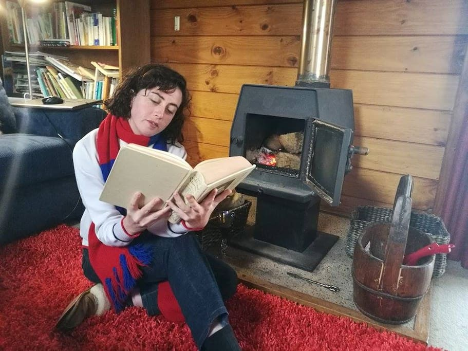 Reading by the fire on a rainy day.