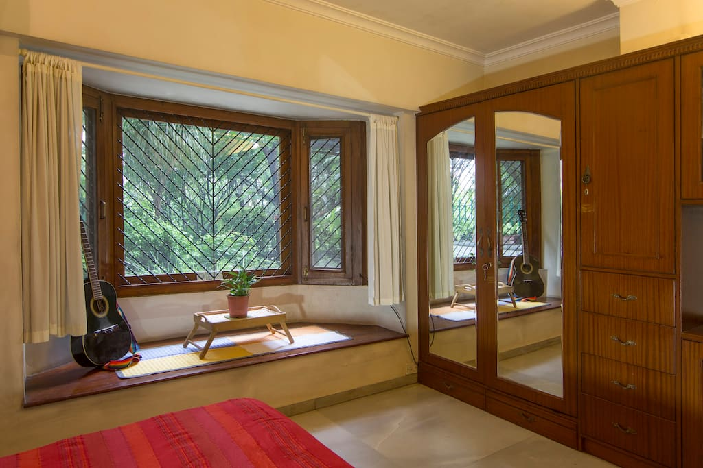 View of bay window and spacious wardrobe.
