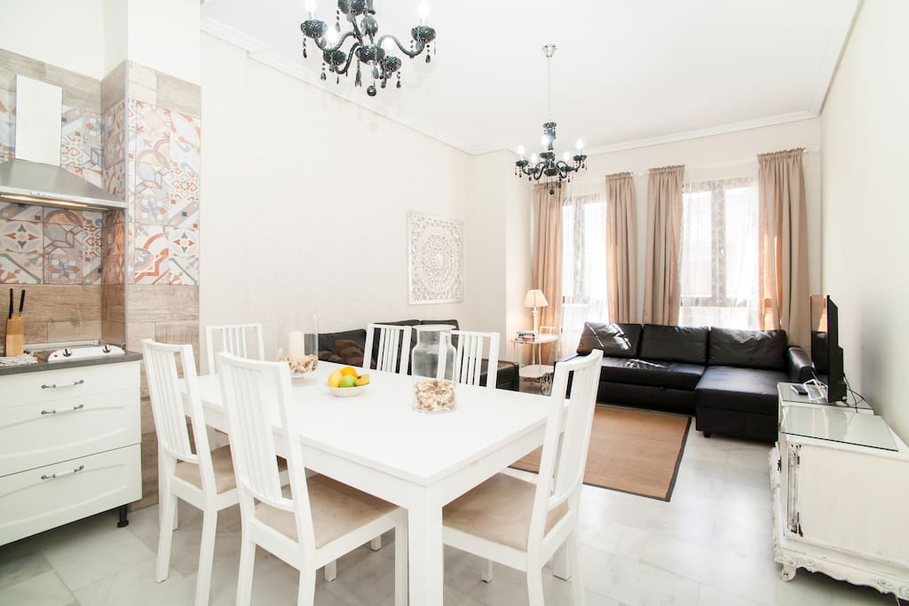 Living room, very large, big table up to 10 people and 2 sofas just for relaxing, watching TV or having a coffe