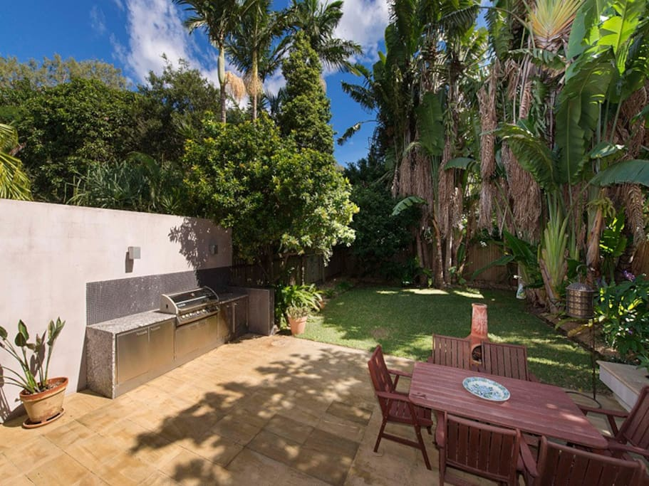 Lush, green outdoor living. Huge barbecue.