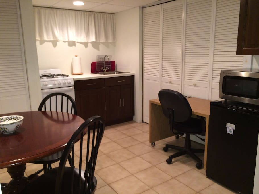 Kitchenette area  with pots, pans, dishes, cups, microwave, small fridge, coffee maker and all untesils needed for meals. Desk area can be used for your laptop or studying. Free wi-fi!!