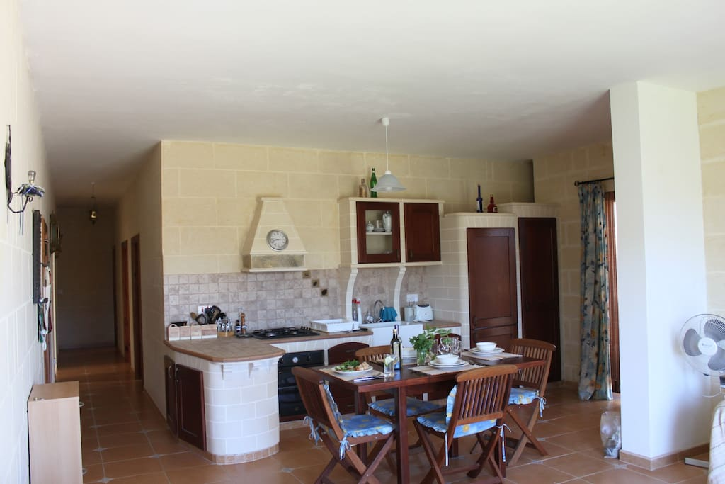 Kitchen includes box room, fridge/freezer electric oven, gas stove, sink, microwave, pots, pans, plates and all necessary cooking utensils etc..