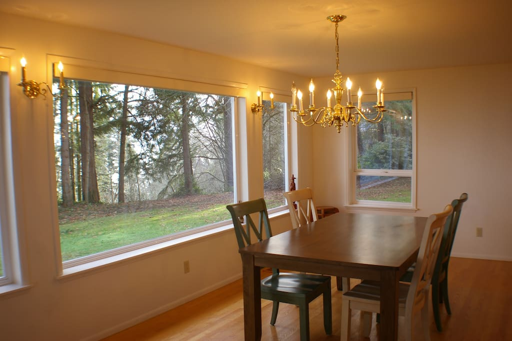 Dinning with expansive views of lawn, trees and sea