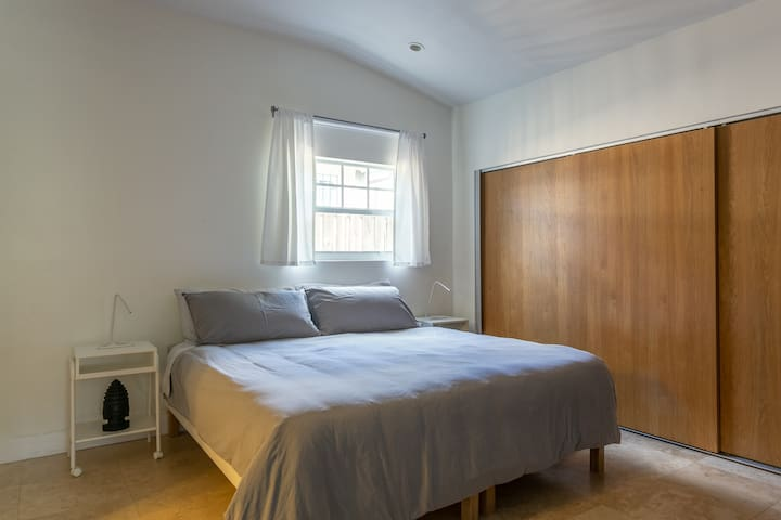 Master Bedroom with new King Size bed and an en-suite bathroom.