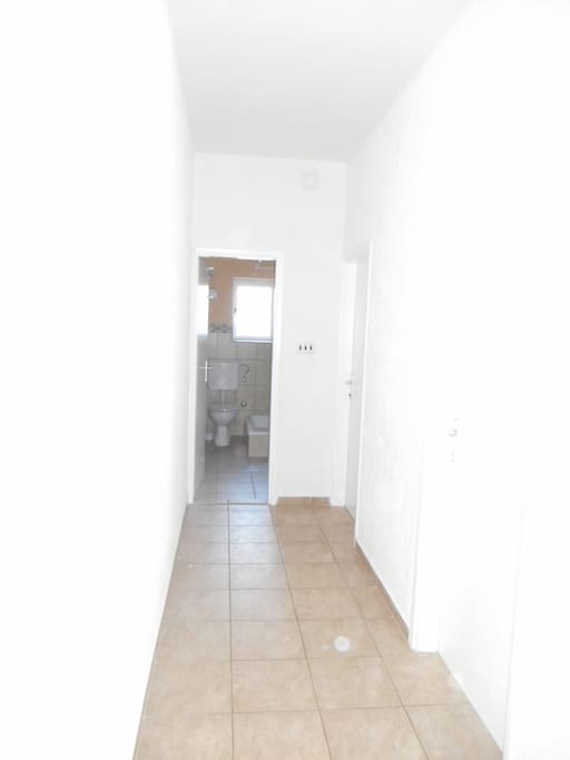 Entering the apartment you can see the hallway. First room to the right contains...