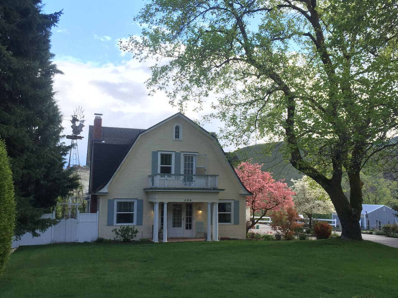 Our 1905 Farmhouse has a large yard with shade to relax and enjoy the weather. Just 5 minutes from town.