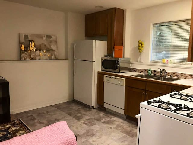 Full Kitchen w/ Fridge, Microwave, Sink and Oven.