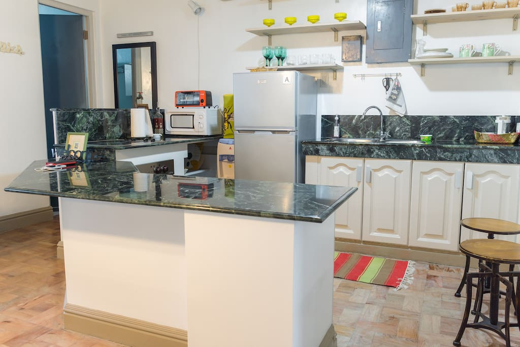 Kitchen with generous cooking & baking countertops..