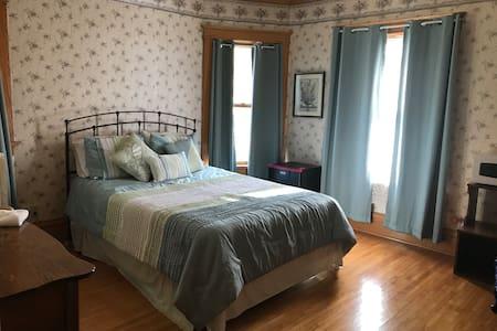 Cozy room has detached bath Across hall
