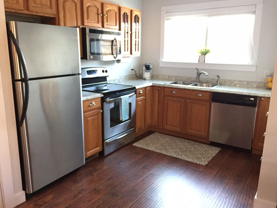 Full kitchen with stainless appliances.