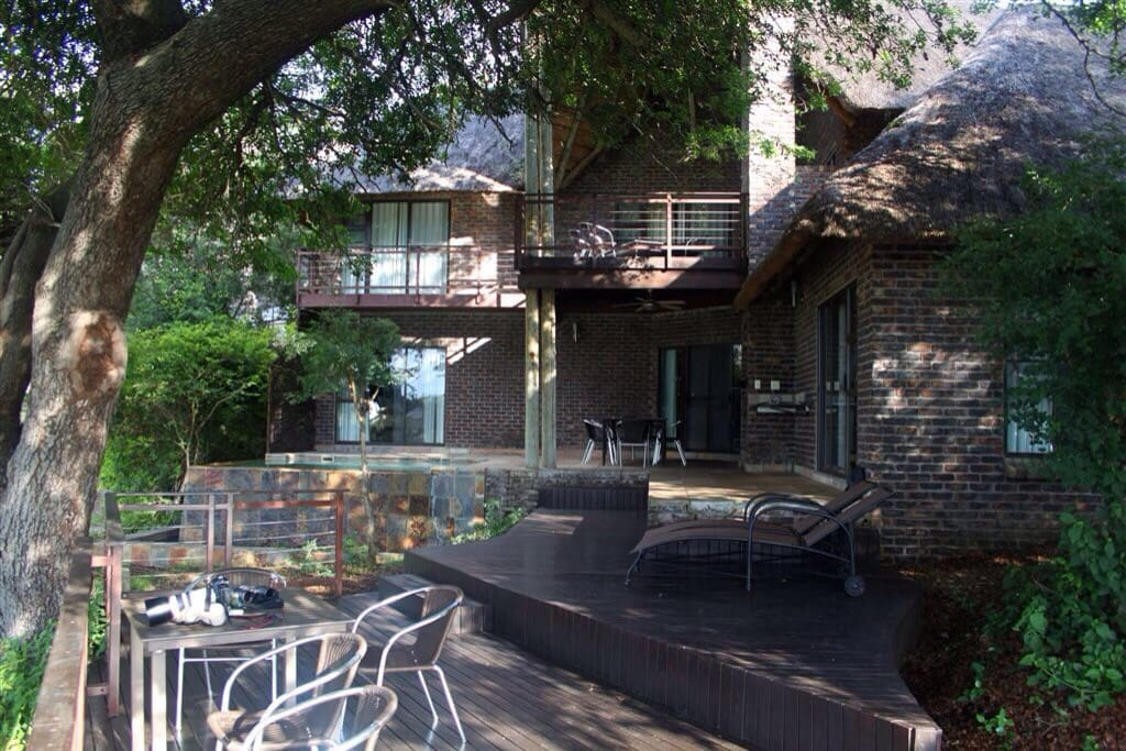 The double storey lodge is surrounded by large riverine trees providing welcome shade.
