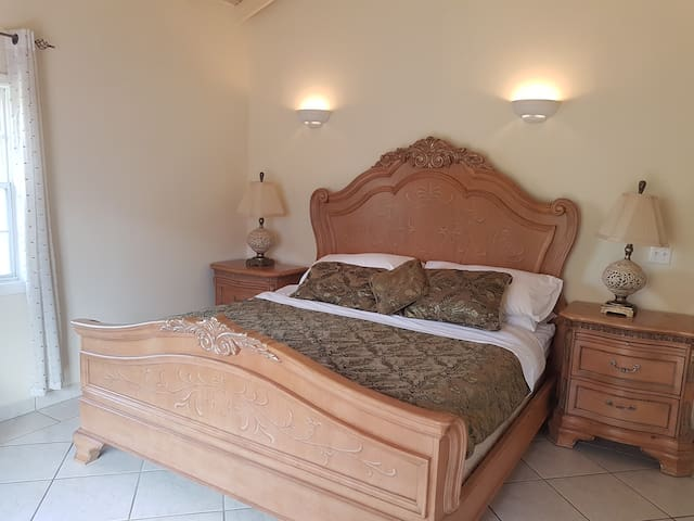 Master Bedroom with American King Size bed. Large airy room with ceiling fan.