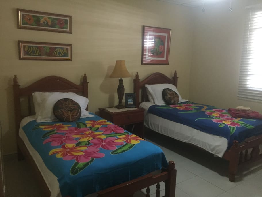 Panamanian styled room with comfortable twin beds.