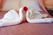 I enjoy making origami towel animals for my guests!