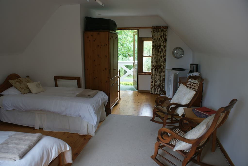 View of Room, 1 queen size closest to camera, 1 singlebed and private entrance