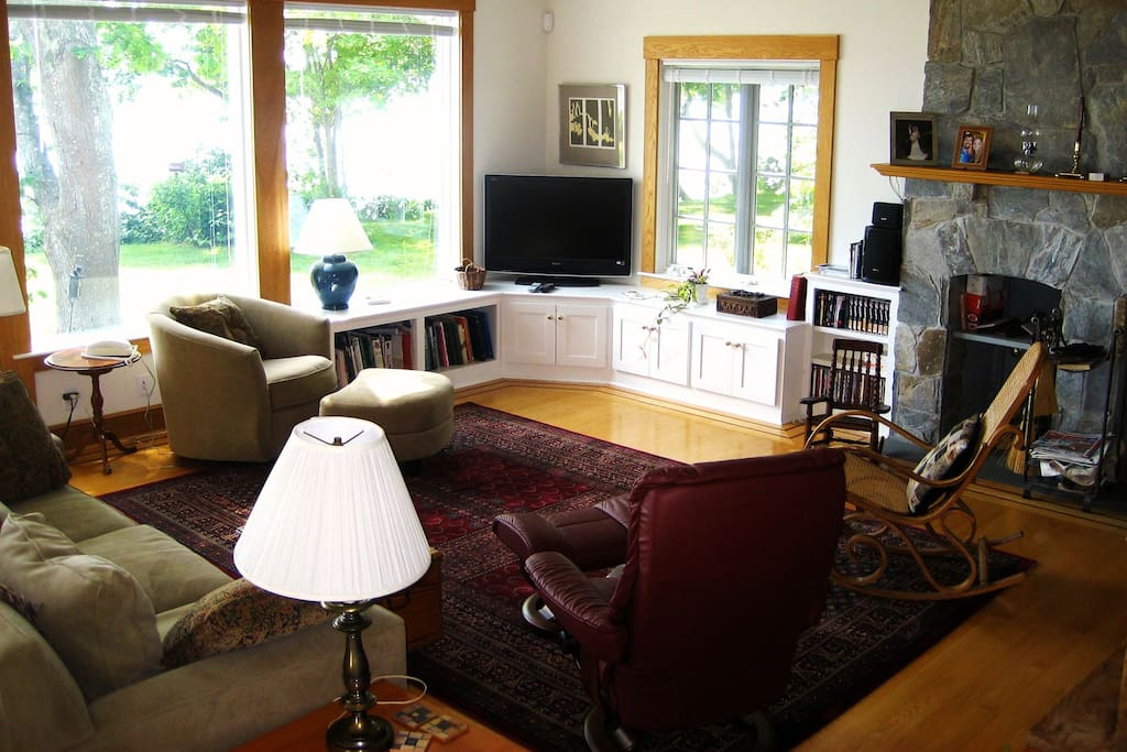 Great room features incredible ocean views and gorgeous stone fireplace.