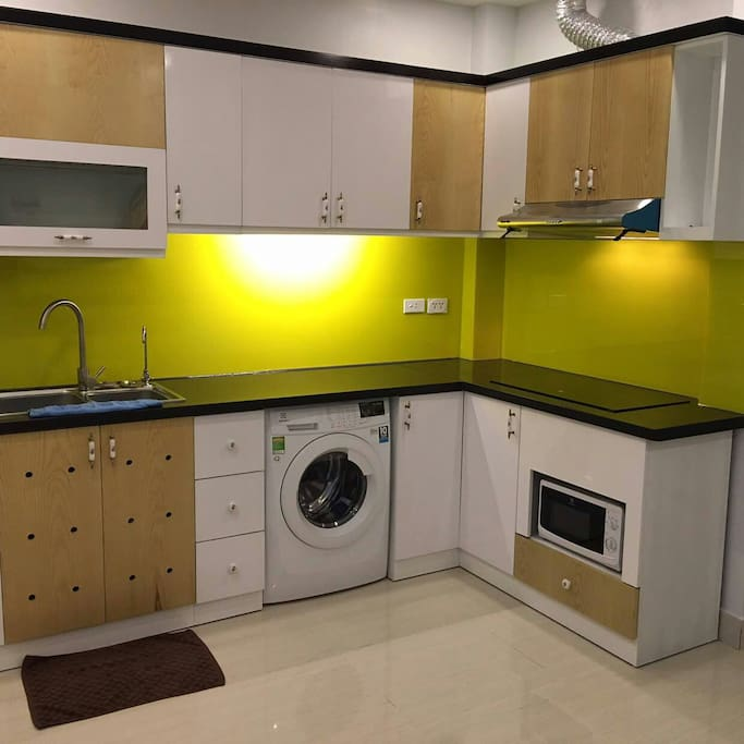 Kitchen, cupboard, microwave, washing machine