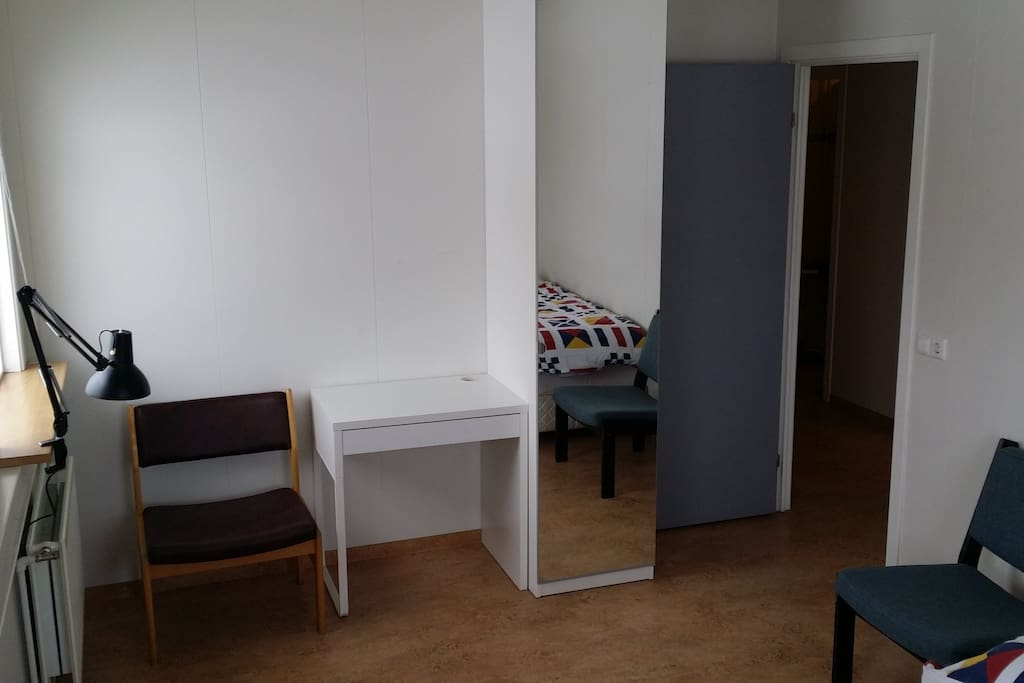 other end of bedroom with desk shown and cabinet