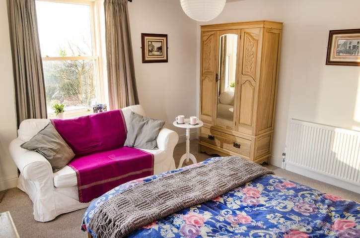 Comfy Sofa next to West Window with views over Canal and the Coast
