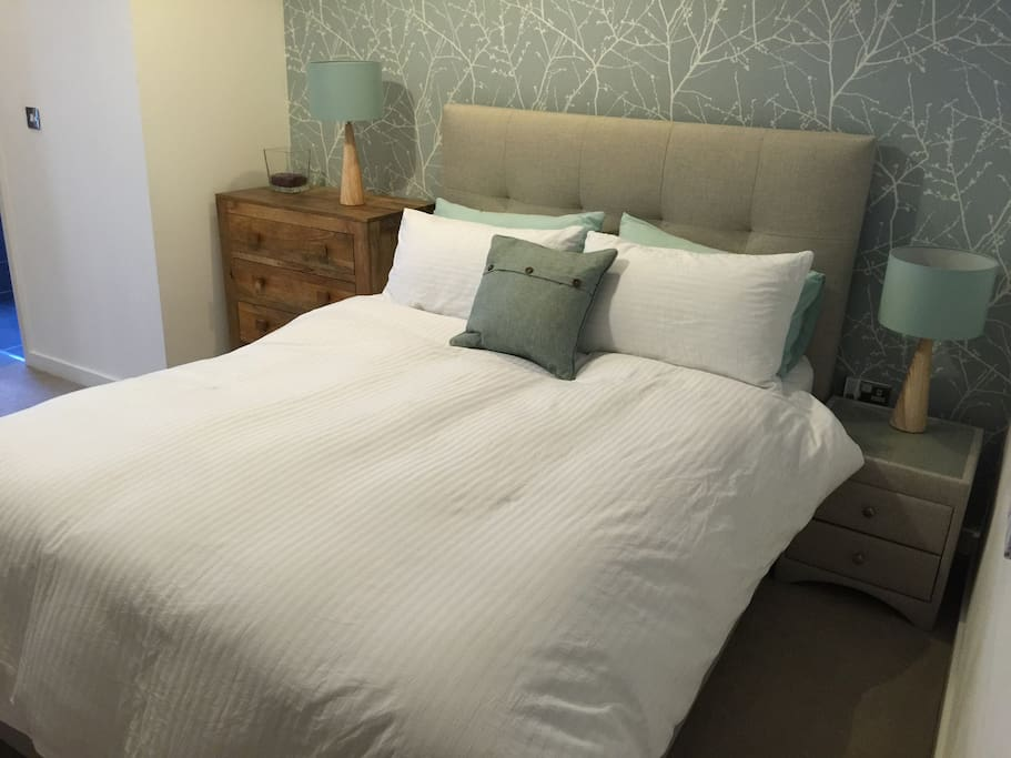 King size bed with goose down duvet and large pillows.