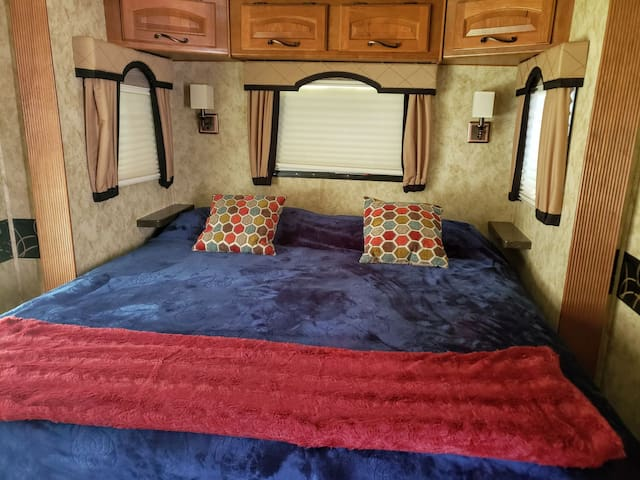 Master bedroom boasts a comfortable king size bed, blind darkening shades and a safe.