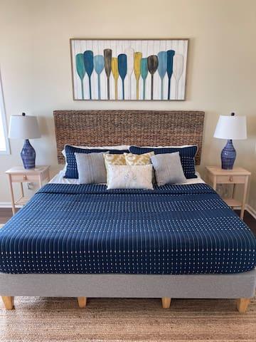 Upstairs king primary bedroom with ocean views.