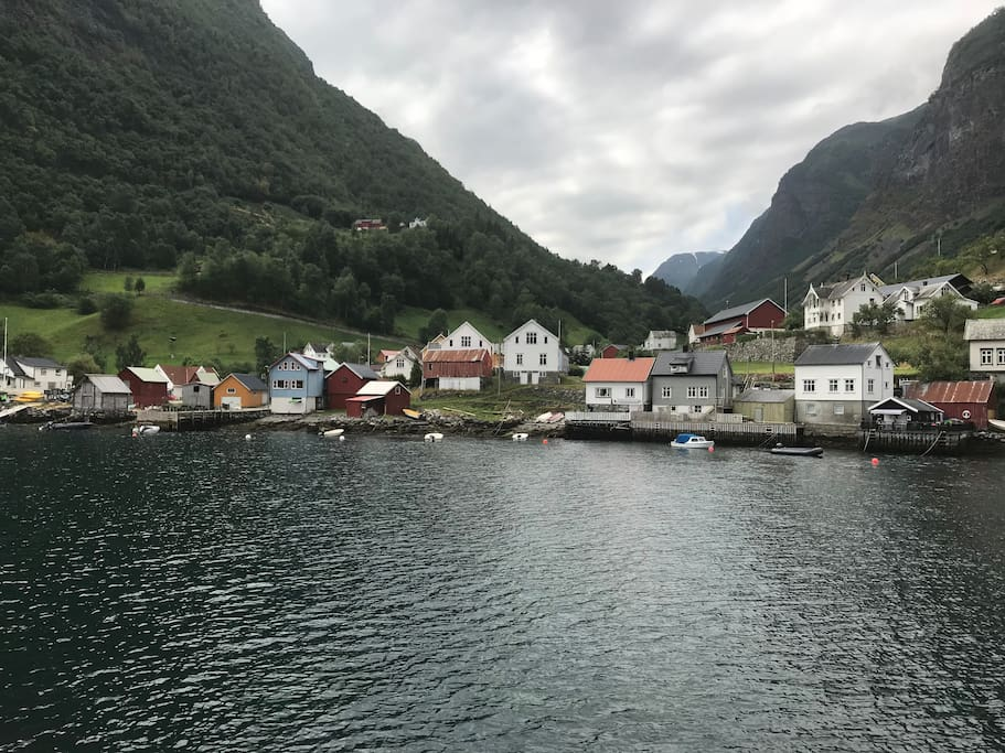 The grey house down at the fjord.