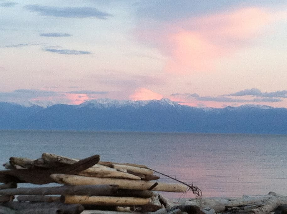 Wake up to this view of the Olympic mountains across from Parry Bay.